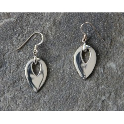 A pair of inverted pear-shaped dropped sterling silver earrings